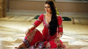 Kareena Kapoor In Red Dress Sitting Pose In Agent Vinod